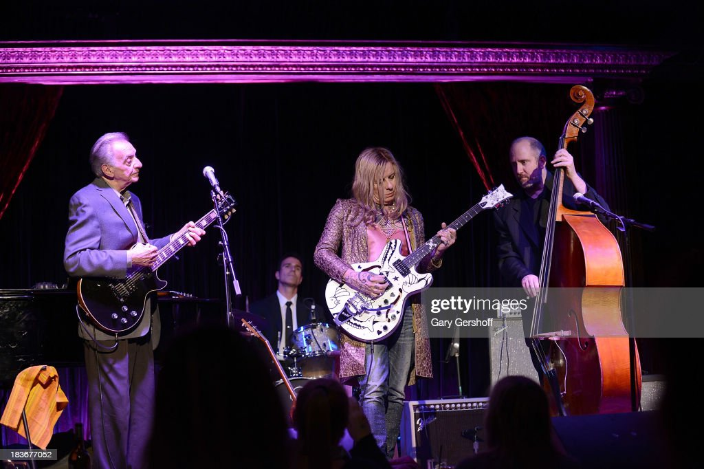 Guitarist Lou Pallo of The Les Paul Trio, Pearl Thompson and Paul Nowinski perform on stage for the book launch of '108 Rock Star Guitars' benefitting The Les Paul Foundation at The Cutting Room on October 8, 2013 in New York City.