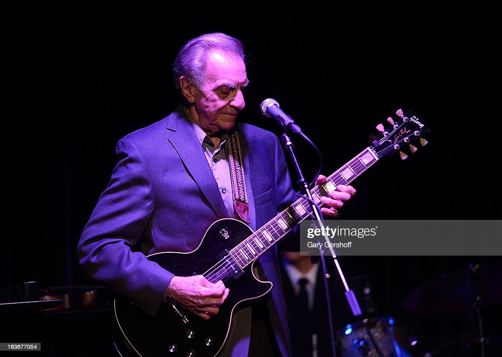 Guitarist Lou Pallo of The Les Paul Trio performs on stage for the book launch of '108 Rock Star Guitars' benefitting The Les Paul Foundation at The Cutting Room on October 8, 2013 in New York City.