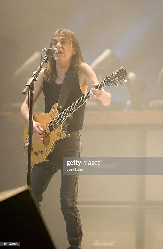 Guitarist <a gi-track='captionPersonalityLinkClicked' href=/galleries/search?phrase=Malcolm+Young&family=editorial&specificpeople=789697 ng-click='$event.stopPropagation()'>Malcolm Young</a> of the Australian rock band AC/DC performs in concert on their 'Black Ice World Tour' at the Conseco Fieldhouse on November 3, 2008 in Indianapolis.