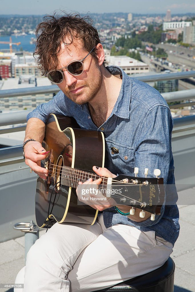Guitarist Matthan Minster of Cage the Elephant performs during an EndSession on the roof-deck at the 107.7 The End radio station on August 27, 2014 in Seattle, Washington.