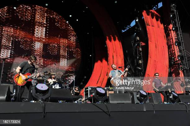 Guitarist Matthew Followill drummer Nathan Followill musician Caleb Followill and bassist Jared Followill of Kings of Leon perform at the 2013 Global...
