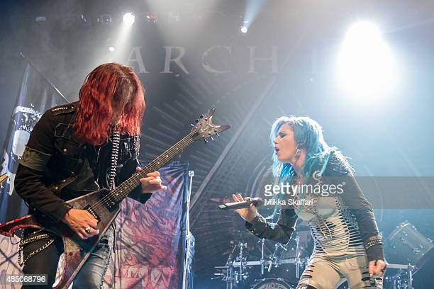 Guitarist Michael Amott and vocalist Alissa WhiteGluz of Arch Enemy perform during The Summer Slaughter Tour at The Regency Ballroom on August 23...