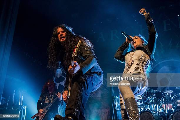 Guitarist Michael Amott bassist Sharlee D'Angelo and vocalist Alissa WhiteGluz of Arch Enemy perform during The Summer Slaughter Tour at The Regency...