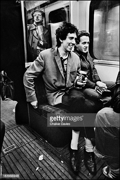 Guitarist Mick Jones and singer Joe Strummer of British punk group The Clash on the London Underground Circle Line in April 1977