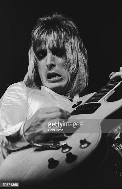 Guitarist Mick Ronson of The Spiders From Mars on stage during David Bowie's last appearance as Ziggy Stardust at the Hammersmith Odeon London 3rd...
