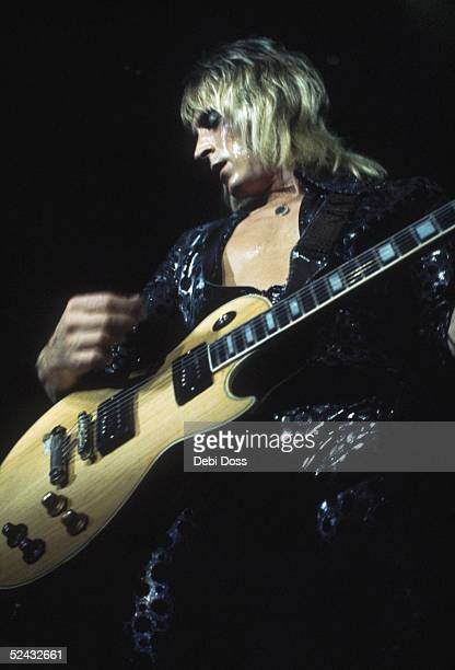 Guitarist Mick Ronson performing with David Bowie and his band at the Hammersmith Odeon 1973