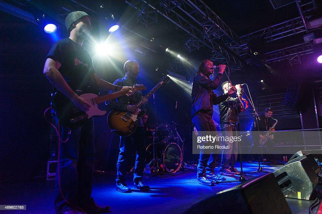 Guitarist Mickey Billingham, Drummer Everett Morton, Ranking Roger and Ranking Junior of The Beat perform on stage at The Liquid Room on February 15, 2014 in Edinburgh, United Kingdom.