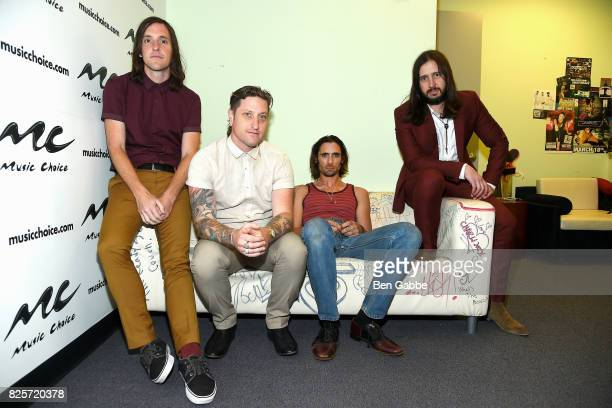 Guitarist Mike Kennerty percussionist Chris Gaylor lead singer Tyson Ritter and guitarist Nick Wheeler of The AllAmerican Rejects visit at Music...