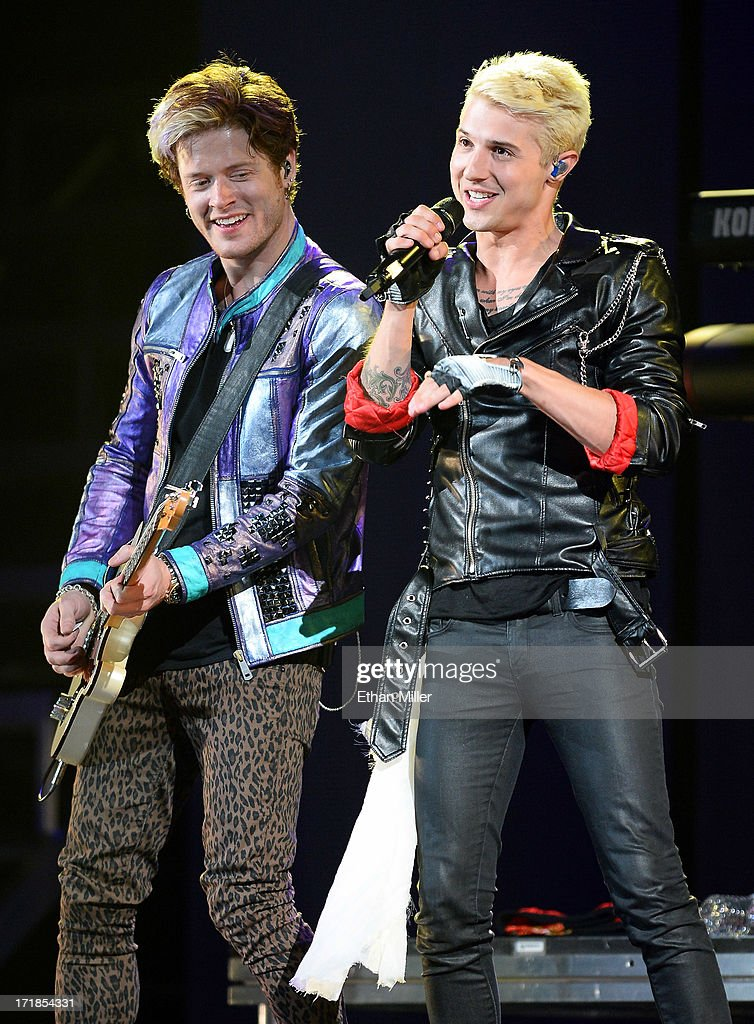 Guitarist Nash Overstreet (L) and singer/guitarist Ryan Follese of Hot Chelle Rae perform as the band opens for Justin Bieber at the MGM Grand Garden Arena on June 28, 2013 in Las Vegas, Nevada.