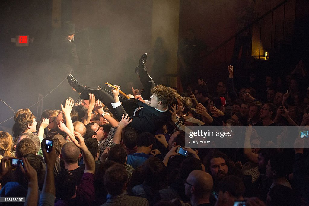 Guitarist <a gi-track='captionPersonalityLinkClicked' href=/galleries/search?phrase=Nicholaus+Arson&family=editorial&specificpeople=228515 ng-click='$event.stopPropagation()'>Nicholaus Arson</a> of The Hives goes crowd surfing as his band performs onstage at The Vogue on March 4, 2013 in Indianapolis, Indiana.