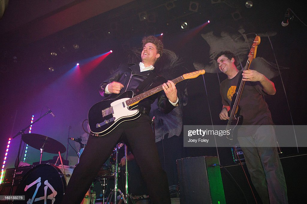 Guitarist Nicholaus Arson (L) of The Hives joins Scott Kellogg (R) and the punk rock band Zero Boys onstage to perform the song 'Civilization's Dying' together in concert at The Vogue on March 4, 2013 in Indianapolis, Indiana.