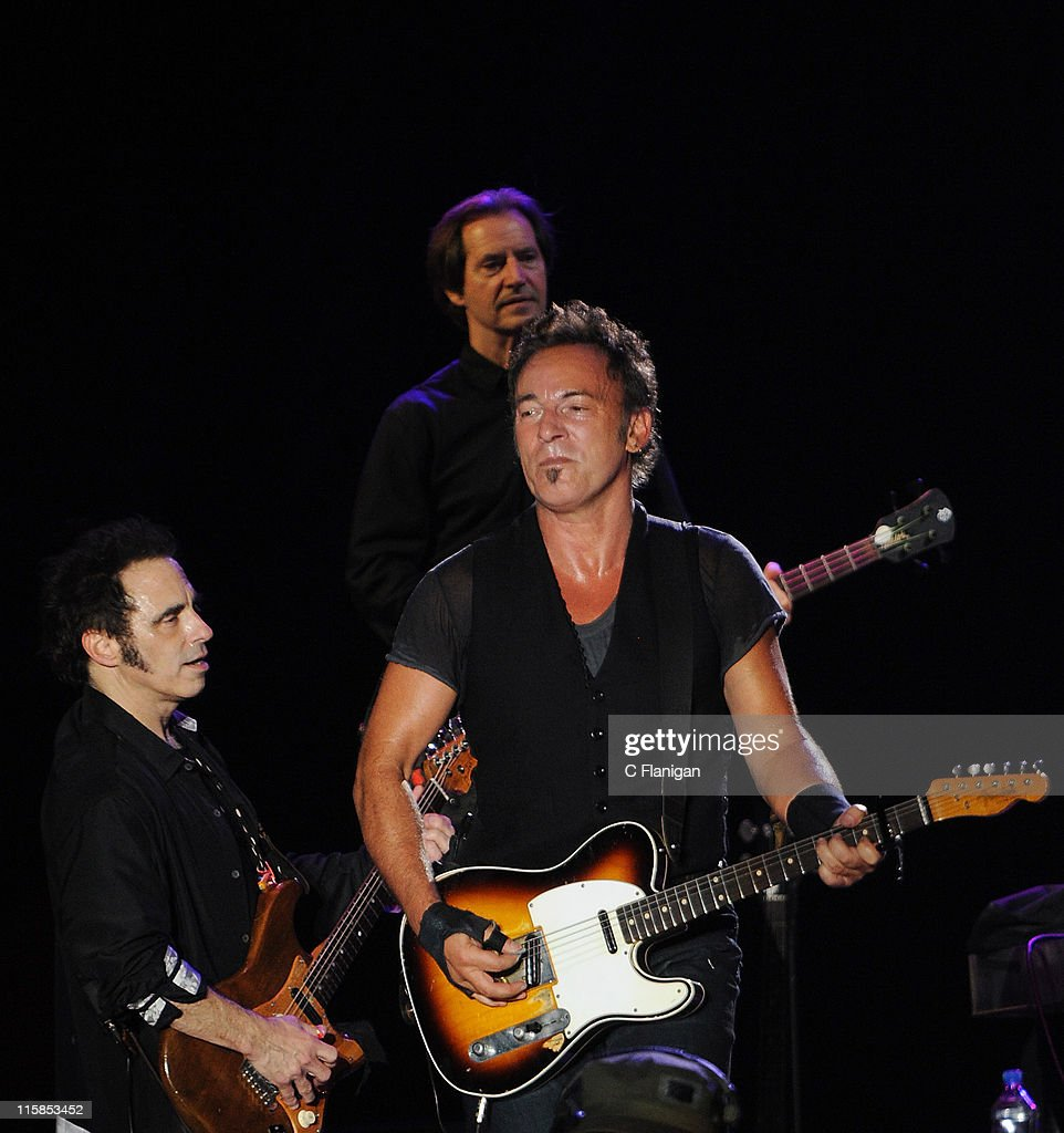 Guitarist <a gi-track='captionPersonalityLinkClicked' href=/galleries/search?phrase=Nils+Lofgren&family=editorial&specificpeople=1645832 ng-click='$event.stopPropagation()'>Nils Lofgren</a> and Vocalist/Guitarist <a gi-track='captionPersonalityLinkClicked' href=/galleries/search?phrase=Bruce+Springsteen&family=editorial&specificpeople=123832 ng-click='$event.stopPropagation()'>Bruce Springsteen</a> perform during the 2009 Bonnaroo Music and Arts Festival on June 13, 2009 in Manchester, Tennessee.