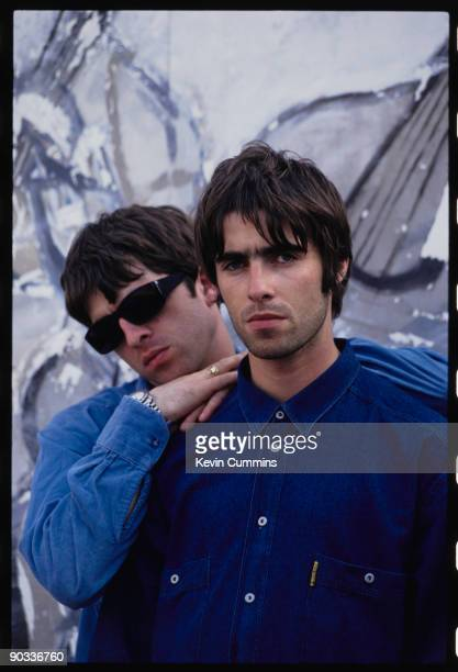 Guitarist Noel Gallagher and his brother singer Liam Gallagher of British rock group Oasis 2nd August 1994