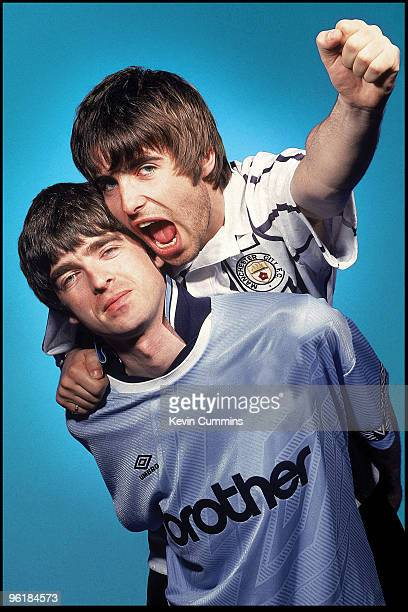 Guitarist Noel Gallagher and his brother singer Liam Gallagher of British rock group Oasis Portsmouth 9th May 1994 Both are sporting Manchester City...