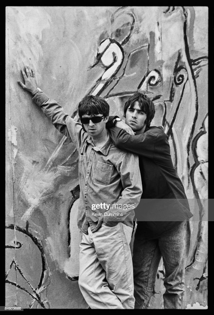 Guitarist <a gi-track='captionPersonalityLinkClicked' href=/galleries/search?phrase=Noel+Gallagher&family=editorial&specificpeople=209146 ng-click='$event.stopPropagation()'>Noel Gallagher</a> (left) and his singer brother <a gi-track='captionPersonalityLinkClicked' href=/galleries/search?phrase=Liam+Gallagher&family=editorial&specificpeople=202958 ng-click='$event.stopPropagation()'>Liam Gallagher</a> of Manchester rock band Oasis, 2nd August 1994.