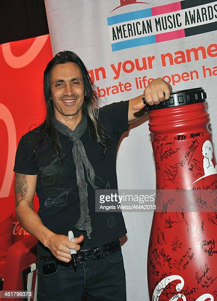 Guitarist Nuno Bettencourt attends day 3 of the 2013 American Music Awards gift lounge at Nokia Theatre LA Live on November 24 2013 in Los Angeles...