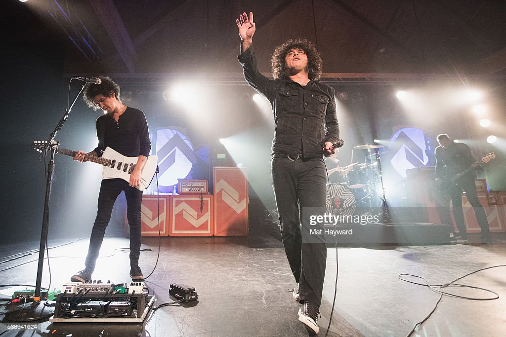Guitarist Omar Rodriguez Lopez and singer Cedric Bixler-Zavala of At The Drive In performs onstage at Showbox SoDo on June 8, 2016 in Seattle, Washington.