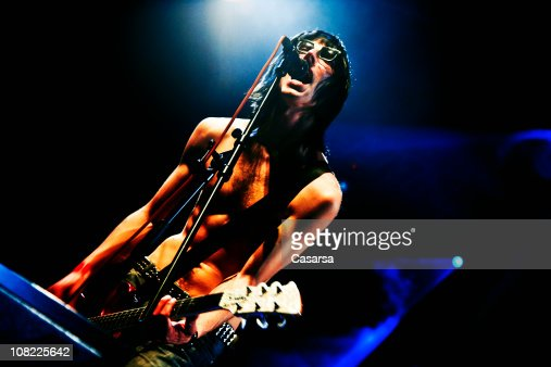 guitarist on stage at rock concert low key stock photo