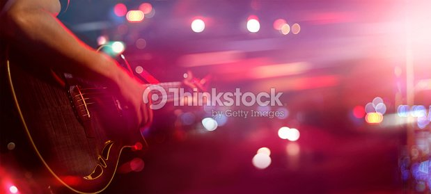 Guitarist on stage for background, soft and blur concept : Stock Photo
