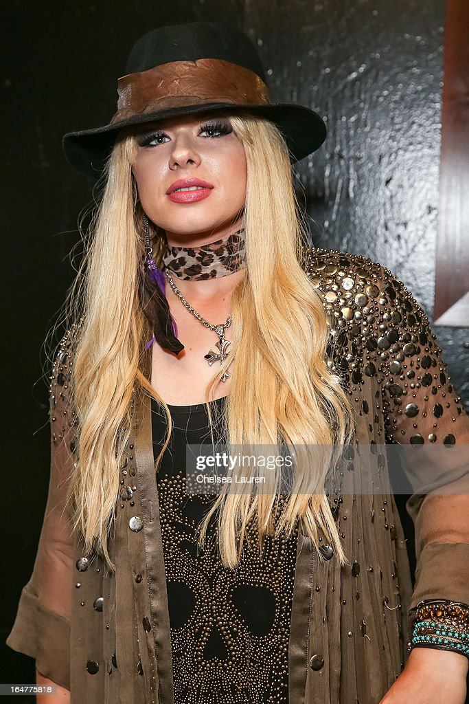 Guitarist Orianthi of Alice Cooper poses backstage at the Rock Against MS benefit concert at The Whisky a Go Go on March 27, 2013 in West Hollywood, California.