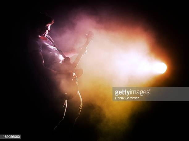 Guitarist performing on stage