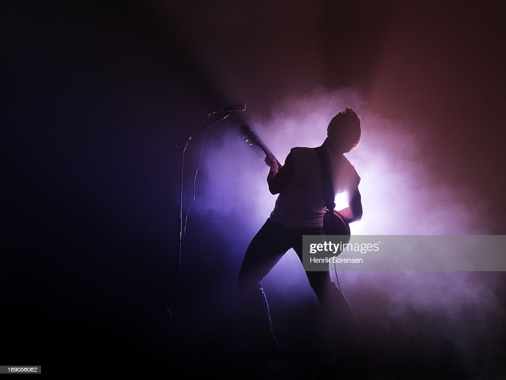 Guitarist performing on stage : Stock Photo