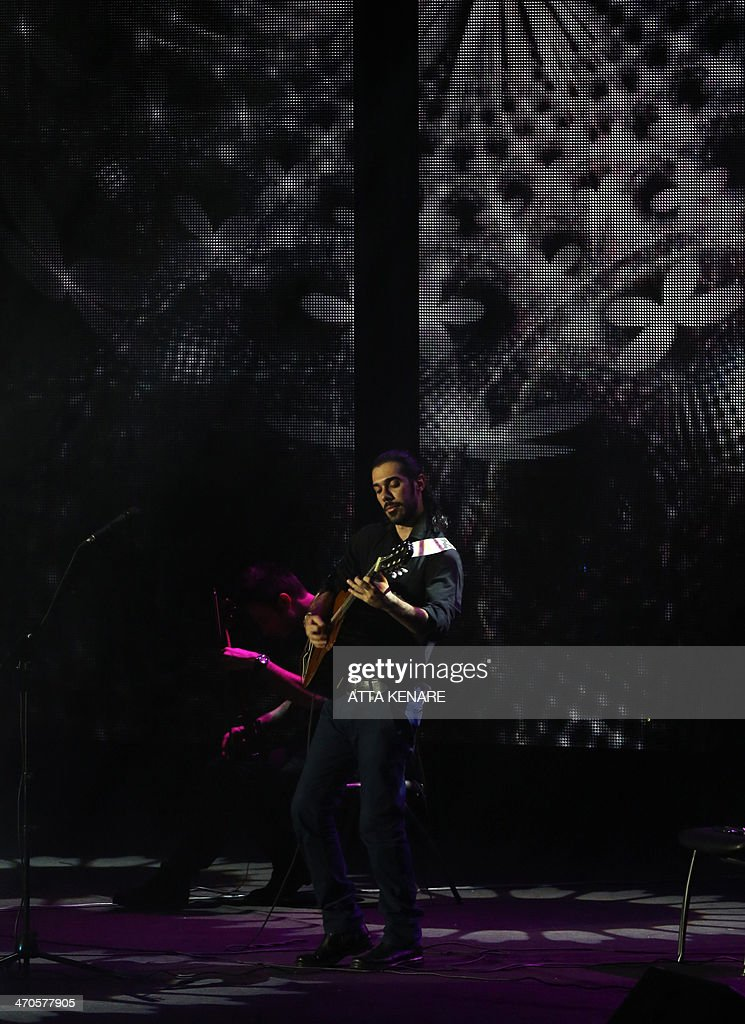 A guitarist performs with Iranian pop singer Mazyar Fallahi (unseen) during the 29th Fajr International Music Festival at the Milad Tower in the capital Tehran, on February 19, 2014. The festival runs until February 20.