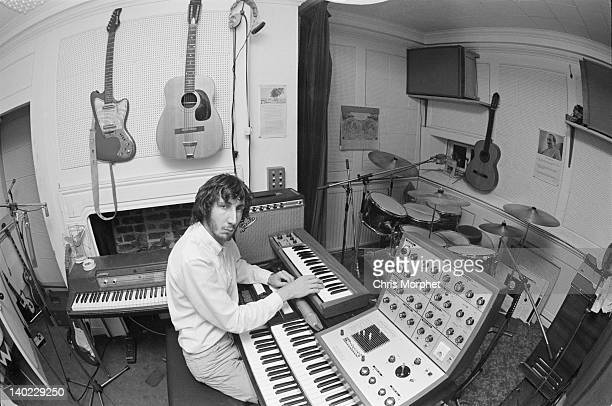 Guitarist Pete Townshend of The Who in the recording studio at his home in Twickenham London 1970 On the wall are a Coral Hornet electric guitar and...