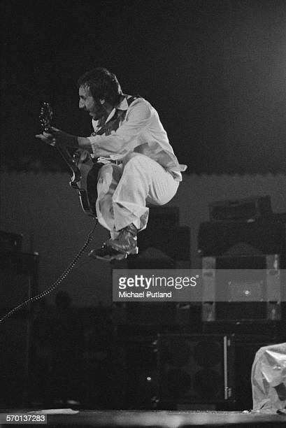 Guitarist Pete Townshend performing with English rock group The Who at Charlton Athletic's football ground The Valley London on the 'Who Put The Boot...