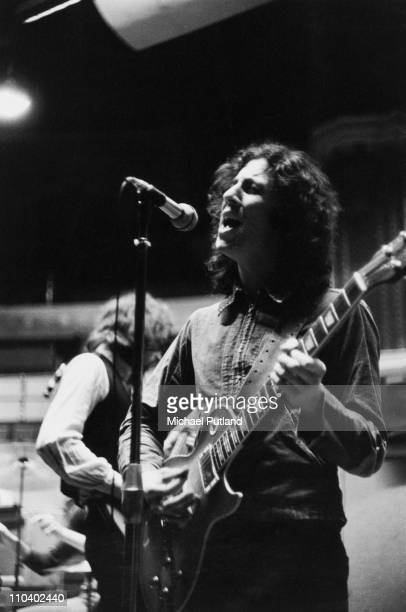 Guitarist Peter Green on stage with British rock group Fleetwood Mac at the Royal Albert Hall London on 22nd April 1969 In the background is bassist...