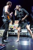 Guitarist Rich Koehler and vocalist Aja Volkman of Nico Vega perform at Gibson Amphitheatre on November 24 2012 in Universal City California