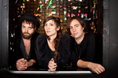Guitarist Rich Koehler vocalist Aja Volkman and drummer Dan Epand of Nico Vega pose backstage at The Roxy Theatre on January 11 2012 in West...