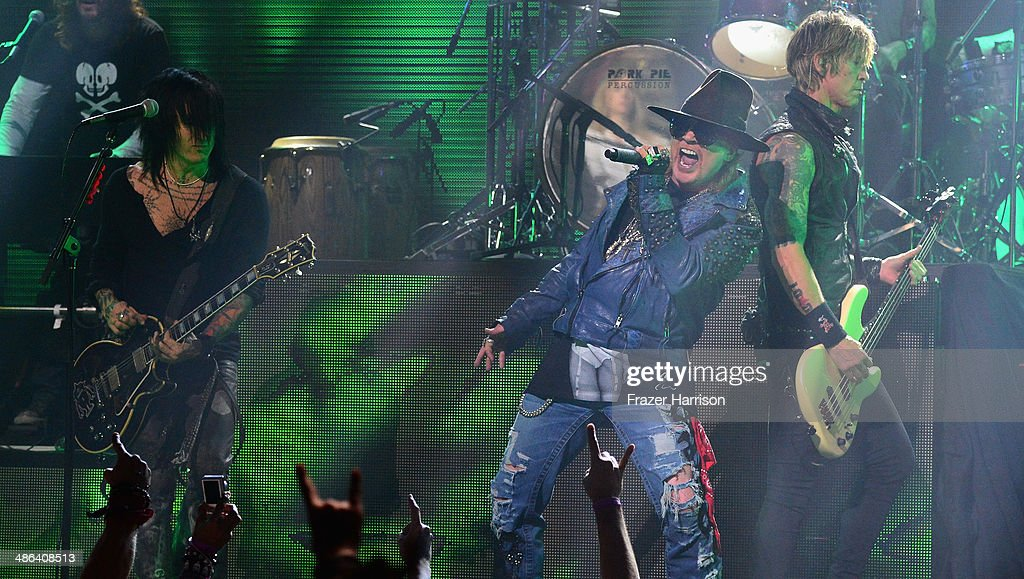 Guitarist Richard Fortus, singer Axl Rose and bassist Duff McKagan perform onstage at the 2014 Revolver Golden Gods Awards at Club Nokia on April 23, 2014 in Los Angeles, California.
