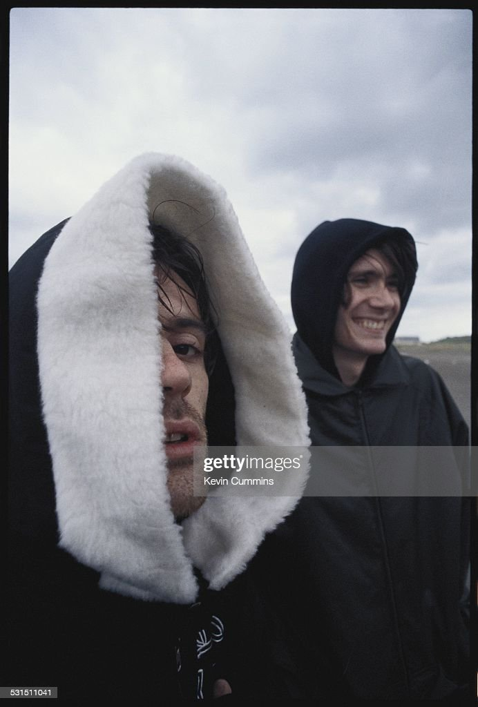 Guitarist Richey James Edwards (left) and bassist Nicky Wire, of Welsh alternative rock group the Manic Street Preachers, on the beach at Swansea, south Wales, 19th August 1994.