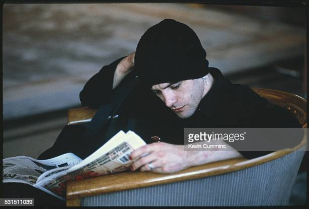 Guitarist Richey James Edwards of Welsh alternative rock group the Manic Street Preachers reading a copy of the NME Bangkok Thailand 27th April 1994