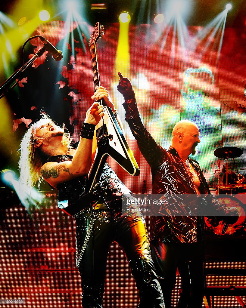 Guitarist Richie Faulkner (L) and singer Rob Halford of Judas Priest perform at The Pearl concert theater at the Palms Casino Resort as the band tours in support of the album 'Redeemer of Souls' on November 14, 2014 in Las Vegas, Nevada.