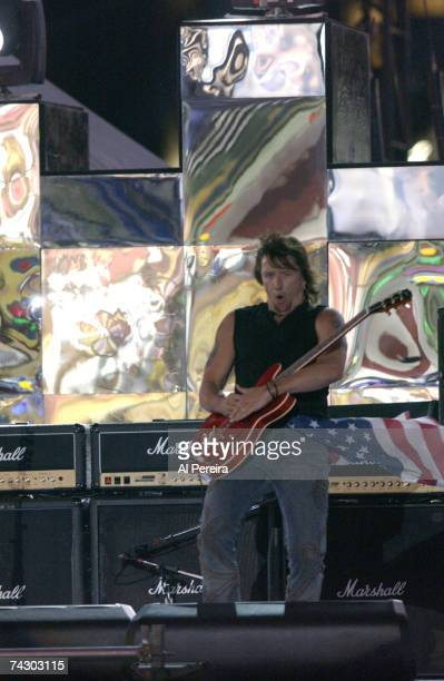 Guitarist Richie Sambora of the hard rock group 'Bon Jovi' performs onstage during NFL Kickoff Weekend in Times Square on September 5 2002 in New...