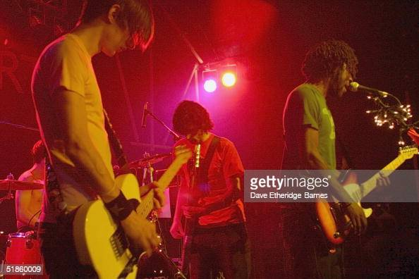 Guitarist Russell Lissack singer Kele Okereke and bassist Gordon Moakes of music group Bloc Party perform on stage at Heaven December 14 2004 in...