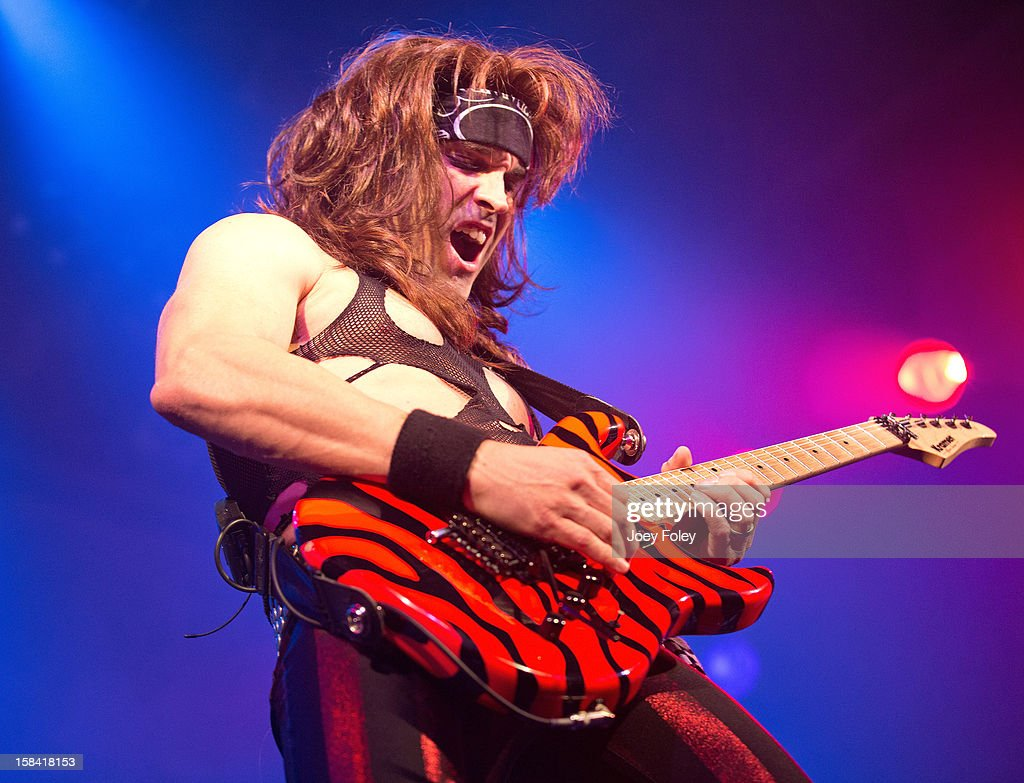 Guitarist Satchel aka Russ Parrish of Steel Panther performs in concert at Bogart's on December 15, 2012 in Cincinnati, Ohio.