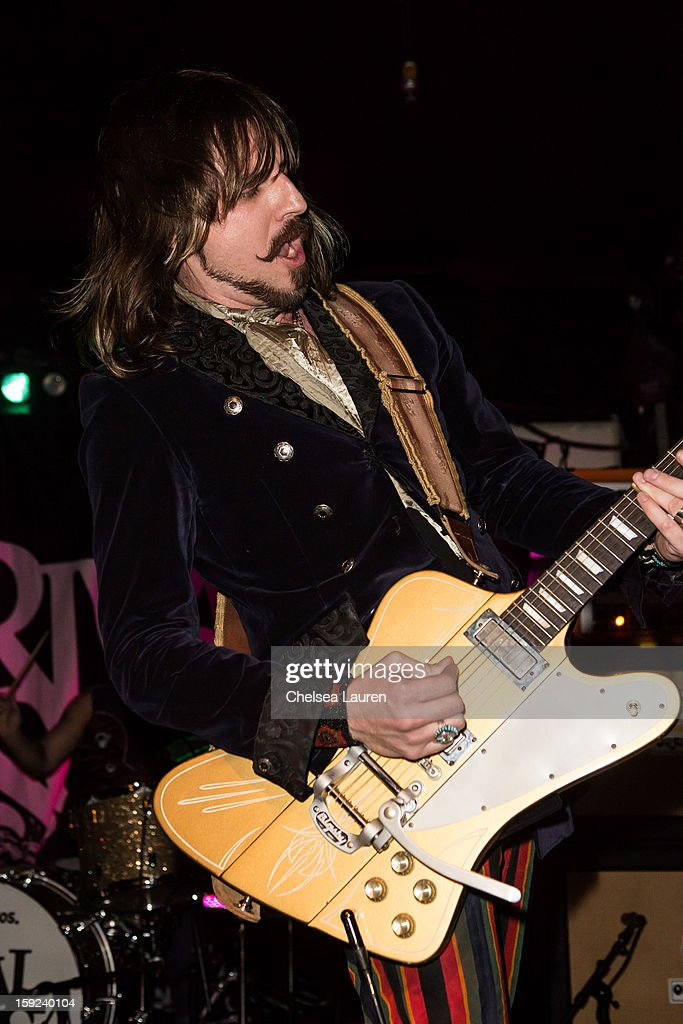 Guitarist Scott Holiday of Rival Sons performs at The Echo on January 9, 2013 in Los Angeles, California.