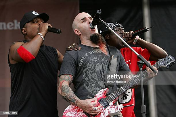 Guitarist Scott Ian of the band Anthrax and recording artists Chuck D and Flava flav of the group Public Enemy performs on stage at the 'Rock The...