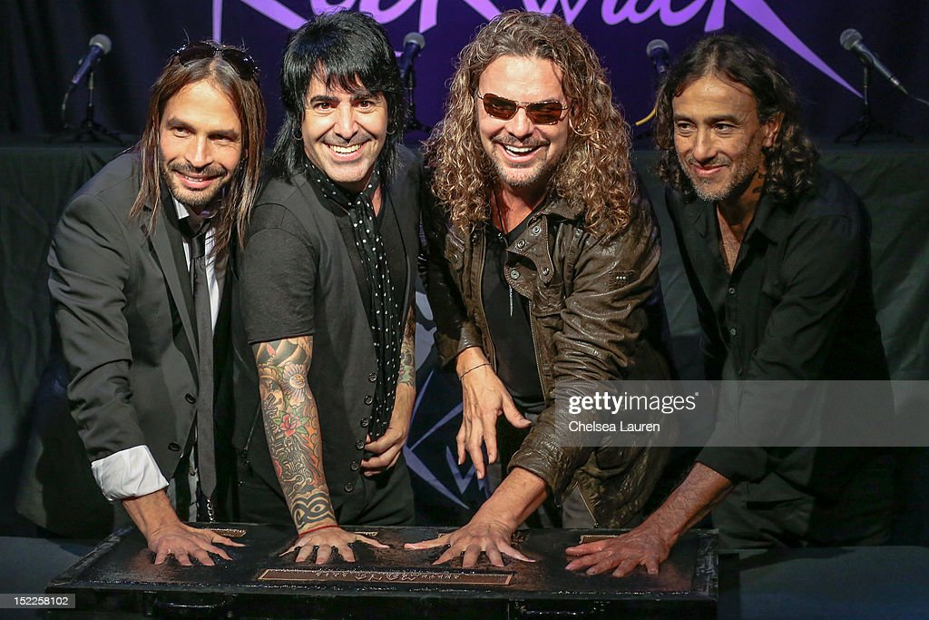 Guitarist <a gi-track='captionPersonalityLinkClicked' href=/galleries/search?phrase=Sergio+Vallin&family=editorial&specificpeople=2331077 ng-click='$event.stopPropagation()'>Sergio Vallin</a>, drummer Alex Gonzalez, vocalist <a gi-track='captionPersonalityLinkClicked' href=/galleries/search?phrase=Fher+Olvera&family=editorial&specificpeople=2331075 ng-click='$event.stopPropagation()'>Fher Olvera</a> and bassist Juan Calleros of Mana are inducted into Guitar Center's RockWalk at Guitar Center on September 17, 2012 in Hollywood, California.
