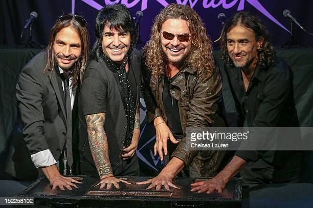 Guitarist Sergio Vallin drummer Alex Gonzalez vocalist Fher Olvera and bassist Juan Calleros of Mana are inducted into Guitar Center's RockWalk at...