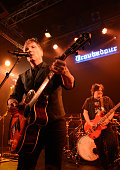 Guitarist / singer John Rzeznik and bass player Robby Takac of The Goo Goo Dolls perform on stage at Troubadour on December 15 2014 in West Hollywood...