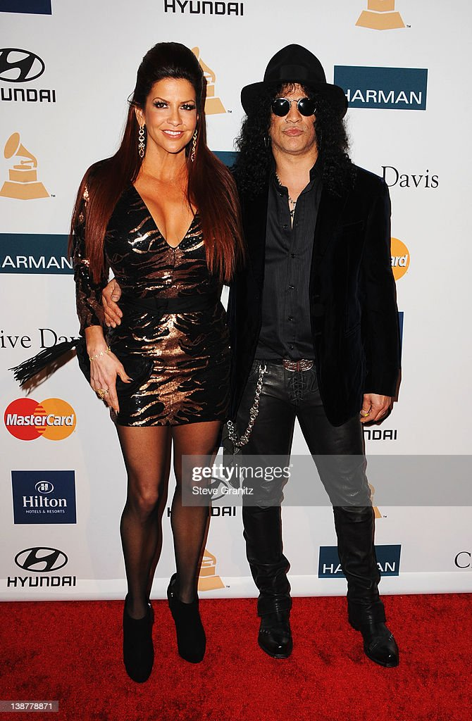 Guitarist Slash (R) and guest arrive at Clive Davis and The Recording Academy's 2012 Pre-GRAMMY Gala and Salute to Industry Icons Honoring Richard Branson at The Beverly Hilton hotel on February 11, 2012 in Beverly Hills, California.