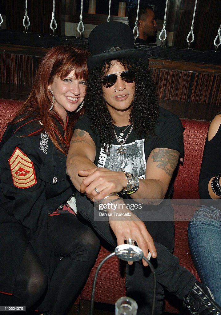 Guitarist Slash and his wife Perla Ferrer attend a Velvet Revolver after party at JET Nightclub at The Mirage Hotel and Casino on September 21, 2007 in Las Vegas, Nevada.