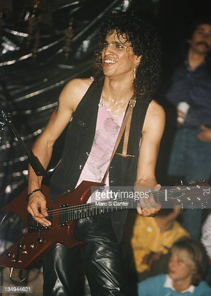 Guitarist Slash of the rock group 'Hollywood Rose' plays a BC Rich electric guitar as they perform at the Madame Wong's on June 16 1986 in Los...