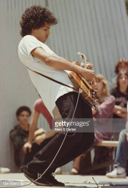 Guitarist Slash plays with his first band 'Tidus Sloan' during lunchtime at Fairfax High School on June 4 1982 in Los Angeles California