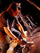 Guitarist smashing guitar