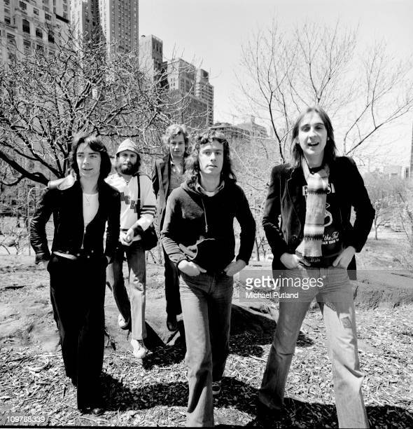 Guitarist Steve Hackett singer Phil Collins drummer Bill Bruford keyboard player Tony Banks and bassist Mike Rutherford in Central Park New York City...
